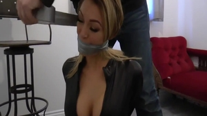 Tied up in company with busty british blonde
