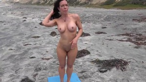 Natural and busty MILF sucking dick at the beach