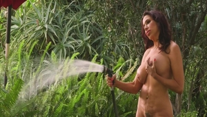 Solo big boobs & busty granny Lisa Marie fingering outdoors