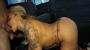 Pussy eating on the backseat escorted by busty babe